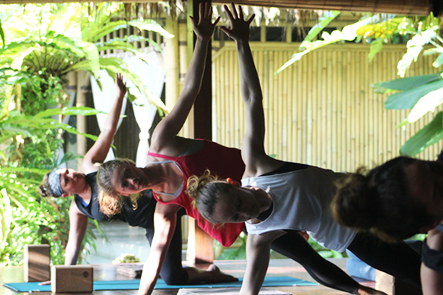 Yoga pose side plank in Bali